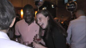 A couple enjoy Boston Magician Joe Ferranti.